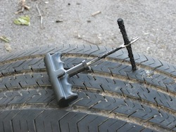 Plugging a tire with the insertion tool