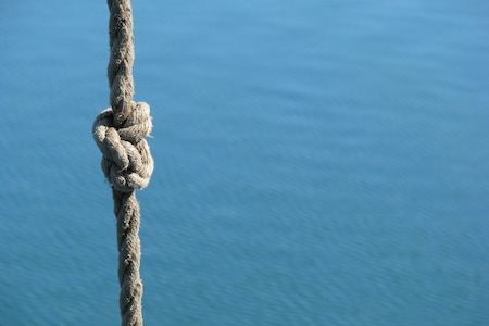 Tying a figure of eight knot